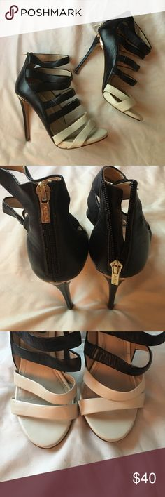 Strappy Aldo heels. Gorgeous, strappy Aldo heels. Black and cream straps, with gold accents. Heel height is 4.5 inches, with a gold zipper on the heel. In great shape, with barely noticeable marks on the cream parts of the shoe (all pictured). Aldo Shoes Heels