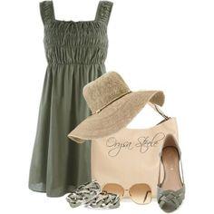 Summer sleeveless dress with straw hat.