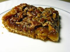 """Crescent roll pecan pie bars    Ingredients:  1 can of refrigerated crescent rolls  1/2 cup chopped pecans  1/2 cup sugar  1/2 cup corn syrup (dark or light, doesn't matter)  1 Tbsp butter, melted  1/2 tsp vanilla  1 egg, beaten    Unroll dough and separate into 2 long rectangles; place in an ungreased 13x9"""" pan and press along the bottom and 1/2"""""""