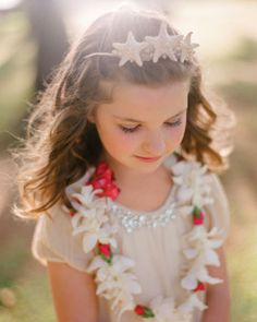 For a wedding in Hawaii, this flower girl wore a starfish tiara and fresh flower lei.