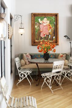 Vintage French garden chairs and a Gustavian bench layered with cheerful suzani-embroidered pillows surround a bespoke Moroccan tile table in the breakfast nook. Eclectic Home, New York Loft, Room Decor, Decor, Decorating Coffee Tables, House Tours, Breakfast Nook Table, Breakfast Nook Bench, Tile Tables