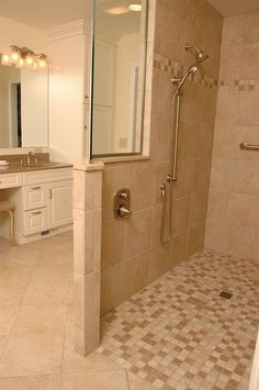 Universal design shower with slip resistant flooring by Neal's Design Remodel.