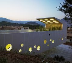 Outside night view. El Tossal Social Centre by CrystalZoo. Click above to see larger image. Concrete Facade, Centre, Golf Courses, Community, Entertaining, Architecture, Places, Facades, Projects
