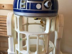 This is a work in progress. A fully printed R2D2 body based on the fabulous work published by James Bruton (check him out on Youtube) but heavily modified for scale / skins along with changes to fit the Dome I designed. This is not a certified build model (not compatible or interchangeable with the official builder spec) as I've designed for complete 3D printing, although I have used reference dimensions to create as accurate as possible. A huge printing job, which I'll update a...