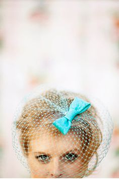 Colored birdcage veil.