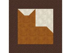 """Try this easy 12"""" patchwork cat quilt block pattern to design a quilt filled with a bunch of your furry friends."""