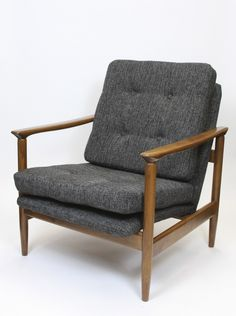 Designed by Edmund Homa during the 1960s, this armchair features a beech wood frame and was manufactured by Gościcińskie Fabryki Mebli in Poland. It has been newly stained and upholstered. In a very good vintage condition.