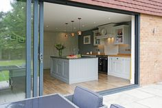 With full height sliding doors, come rain or shine this family wanted to feel connected to their garden, so they can prep food with an eye on the children zooming up and down on the patio on their scooters or singing on the swings. Extension Designs, Handmade Kitchens, Inside Outside, Bespoke Kitchens, Bespoke Design, Swings, Surrey, Scooters, Sliding Doors