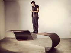 Poised Table. The grace and suppleness of paper in a sheet of steel by Paul Cocksedge Studio™