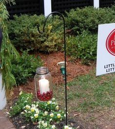 Great idea for DIY holiday lanterns to line a walkway: shepherd's hook, wire, mason jar, cranberries and a candle.