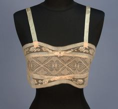 Lace Bandeau Brassiere - 1920's. It offered no support but would allow a woman to achieve the popular narrow rectangle figure of the day by allowing the breasts to sag without appearing indecent.