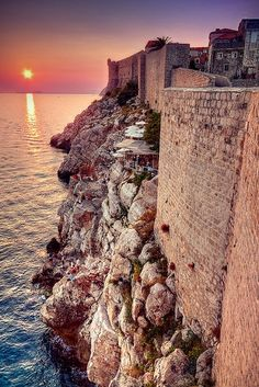 Dubrovnik, Croatia. The cliff side bar   pictured has awesome views, and is one of the lovliest places in the world to   have a drink.