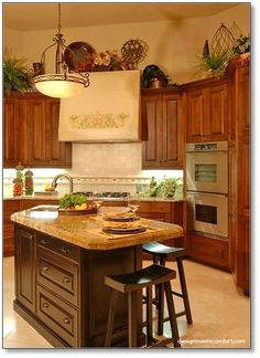 great ideas for accessories above upper kitchen cabinets. beautiful ideas. Home Design Ideas