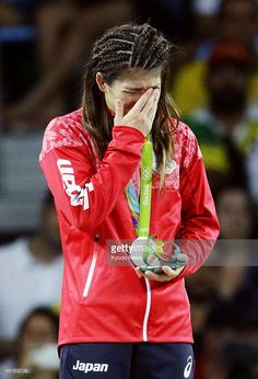 Silver medalist Saori Yoshida of Japan cries during the medal ceremony for the women's freestyle wrestling 53-kilogram class at the Rio de Janeiro Olympics on Aug. 18, 2016.
