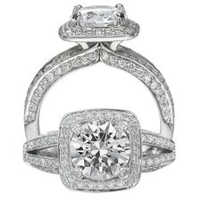 Masterwork diamond engagement ring featuring a cushion halo with a round cut centerstone that is surrounded by micropavé diamonds and a split shank with micropavé diamonds.