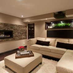 Love the built in fireplace into this basement. Fireplace = essential in basement.