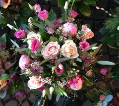 Pink bouquet featuring roses, peonies, astrantia, lisiathus and wax flower