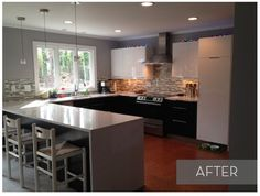 Although this kitchen had bright white cabinets, they couldn't make up for the bank of overhead cabinets that closed off the space and made it rather dark. Out went the over head cabinets and in went... nothing.