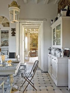 shabby chic vintage french white kitchen.  Beautiful lamp and floor too.  #heirloomheaven