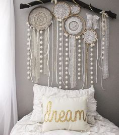 """Jenna on Instagram: """"Skyler and I made some quick doily dream catchers and put them on her pompom branch today. She had fun adding all the lace and different ribbons in, and I love that she did so much work on it. It makes it more """"hers."""" She saw a dream catcher wall like this when she was looking at Pinterest and wanted one similar! Dream pillow is from @kirklands ❤️"""""""