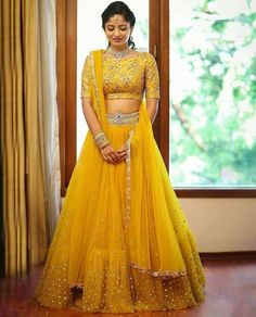 Gear up for the upcoming festive days with 15 Yellow Lehenga Choli designs. These gorgeous chaniya choli designs are perfect for day and night parties! Raw Silk Lehenga, Half Saree Lehenga, Yellow Lehenga, Lehnga Dress, Indian Lehenga, Indian Gowns, Net Lehenga, Lehenga Blouse, Bollywood Lehenga