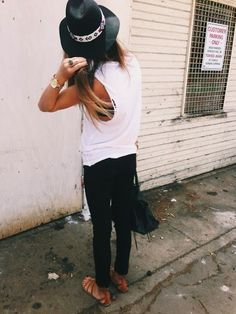 White muscle tank , black skinny jeans , sandals