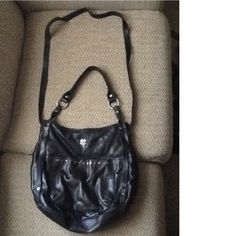 """HERE WE HAVE A WONDERFUL LUCKY BRAND SOFT BLACK LEATHER CROSSBODY TOTE HAND BAG.  THE FRONT SIDE HAS THE LUCKY BRAND LOGO, AND THE OPPOSING SIDE HAS A PRETTY, METAL STUDDED FOUR LEAF CLOVER ACCENT!  IT IS IN EXCELLENT CONDITION AND CLEAN INSIDE, HAS A NICE BROKEN IN LOOK AND FEEL.   THE INSIDE HAS  A ZIPPER COMPARTMENTS AND  2 SLOT COMPARTMENTS THAT HAVE SNAPS ON THEM. THE BAG CLOSES WITH A SNAP.   14""""x 12.5"""".  THIS IS TRULY A BEAUTIFUL BAG!  WILL SHIP RIGHT AWAY,  CHECK OUT MY OTHER ITEMS"""