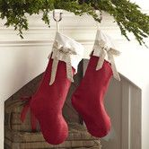 Love the simplicity of a red stocking, here with a cream cuff and linen bow detail.