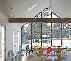 Self-taught designer Tom Givone resuscitated his 19th-century homestead by inserting a wall of skyscraper glass beneath a gabled extension on his wood-framed farmhouse. The spare but cozy kitchen now has a larger-than-life window onto the surrounding scenery. Photo byMark Mahaney.  Photo by: Mark Mahaney