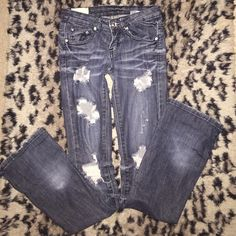 """""""Machine"""" ripped jeans """"MACHINE"""" Bootcut Ripped blue jeans with rhinestone embellishments. Fleur di les design on back pockets ❗️SOME RHINESTONES ARE MISSING FROM THE BACK POCKETS. All else is in good condition. Small fade near the bottoms where I would roll up the jeans. Machine Jeans Boot Cut"""
