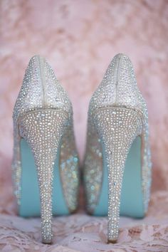 Pale blue and silver glittery high heels for a stunning winter wonderland wedding.