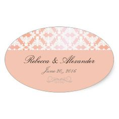 Sold! Oval coral colored wedding sticker accented with a pink and coral damask pattern.
