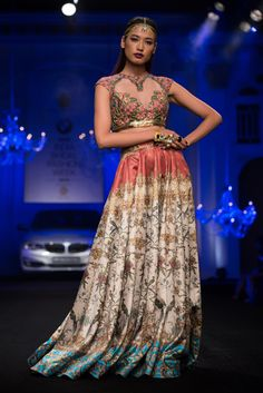 Indian bridal lehnga with heart shaped blouse cutout by Falguni & Shane Peacock. More here: http://www.indianweddingsite.com/bmw-india-bridal-fashion-week-ibfw-2014-falguni-shane-peacock-show/
