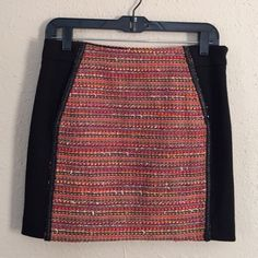 """RACHEL Rachel Roy Black Multicolor Tweed Skirt Preloved skirt, worn once, still in excellent condition. Black and multicolored tweed skirt with faux leather braiding along outline of tweed, two front pockets, 50% acrylic, 35% polyester, 9% wool, 6% polyamide. Waist measures 15"""" and length is approx 15.5"""". ❌NO TRADES OR PAYPAL❌ RACHEL Rachel Roy Skirts Mini"""