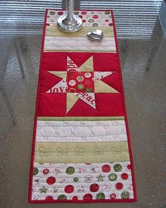 Christmas Table Runner...looks like a fast easy table runner for any time of the year  Like this pattern http://www.mccallsquilting.com/content_downloads/Artful_Simplicity_Web_Bonus.pdf
