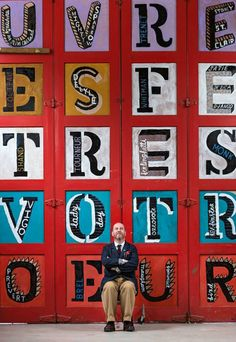 """Jonny Hannah with the painted letters he created for his """"The Darktown Billets-Doux"""" exhibition with St Jude's in Edinburgh, April 2015"""
