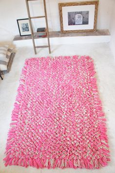 Palmoita hand-loomed wool bouclé area rug in hotpink by mexchic