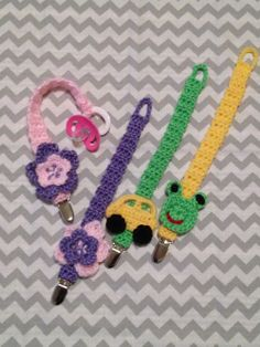 Handmade, crochet pacifier clips. These are a great gift for baby showers.