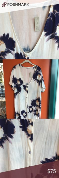 Flynn Skye, Calin midi slit floral button up dress Never worn, tags on, perfect condition. Midi dress with leg slits. White with purple floral pattern. Buttons down the middle. Flynn Skye Dresses Midi