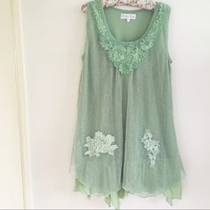 "Mint Green Floral Beaded Tank Dress Beautiful mint green dress featuring florals and beads! The dress also has sequins placed throughout it. So pretty mermaid vibes! Wear to the beach or pair with heels! Size medium an oversized fit in good condition no holes/stains light wear Fabric: linen/poly/cotton Measurements: Length 32"" Chest 18"" YES to: Bundle Discounts NO to: Trades / Modeling / Holds  Happy Poshing!!  Pretty Angel Dresses Mini"