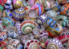 Now I know what to do with all the empty snail shells I find! Paint them to add a colourful touch to any faery garden :D