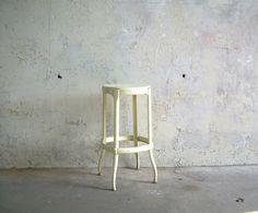 Vintage Yellow Metal Stool Retro Kitchen Seat  Very light lemon custard yellow painted finish.  A nice vintage patina, paint splatters and