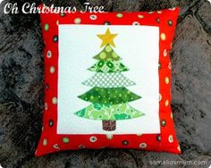 Oh Christmas Tree Pillow Design | FaveQuilts.com - Maybe make lots of these and sew together to make a lap quilt? Different color trees - Christmas greens, then a blue one, etc. Could be fun.