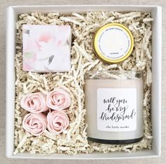 The Bridesmaid Proposal - Teak and Twine Gift Box: Will you be my Bridesmaid? OR Will you be my Maid of Honor? candle by The Little MarketLavender lip balm by The Honey HutchBlush rosette soapsSugarfina champagne sweets wrapped in a watercolor floral wrap Bridesmaid Boxes, Bridesmaid Proposal Gifts, Bridesmaid Gift Baskets, How To Ask Your Bridesmaids, Bridesmaid Necklace Gift, Bridesmaid Dresses, Wedding Dresses, Wedding Favors, Wedding Gifts