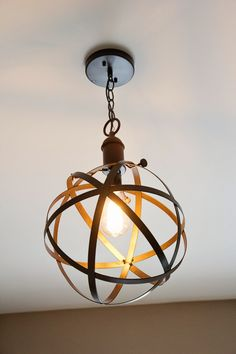 Industrial rustic pendant light for the exposed bulb in the laundry room