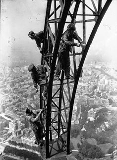 Painting the Eiffel Tower, Paris, France in 1932