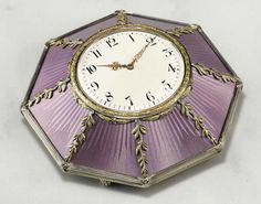 A JEWELED TWO-COLOR GOLD-MOUNTED SILVER-GILT AND GUILLOCHÉ ENAMEL DESK CLOCK  MARKED K. FABERGÉ WITH THE IMPERIAL WARRANT, MOSCOW, 1899-1908, SCRATCHED INVENTORY NUMBER 26063  Octagonal on four reeded ball feet, enameled in translucent lilac over a sunburst guilloché ground and applied with laurel branch and berry bands at corners, set with rose-cut diamonds, rising to a white enamel dial within a laurel-chased border, black Arabic chapters and pierced gold hands