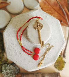 Key necklace with coral stones