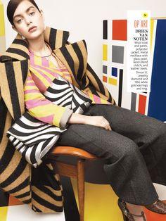 Dries Van Noten, via Instyle August 2014.  Love the striped wool coat and wool oversized clutch! #geometricheaven!