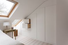 Clever storage in this master bedroom maximises the use of space in the eaves of this loft conversion.